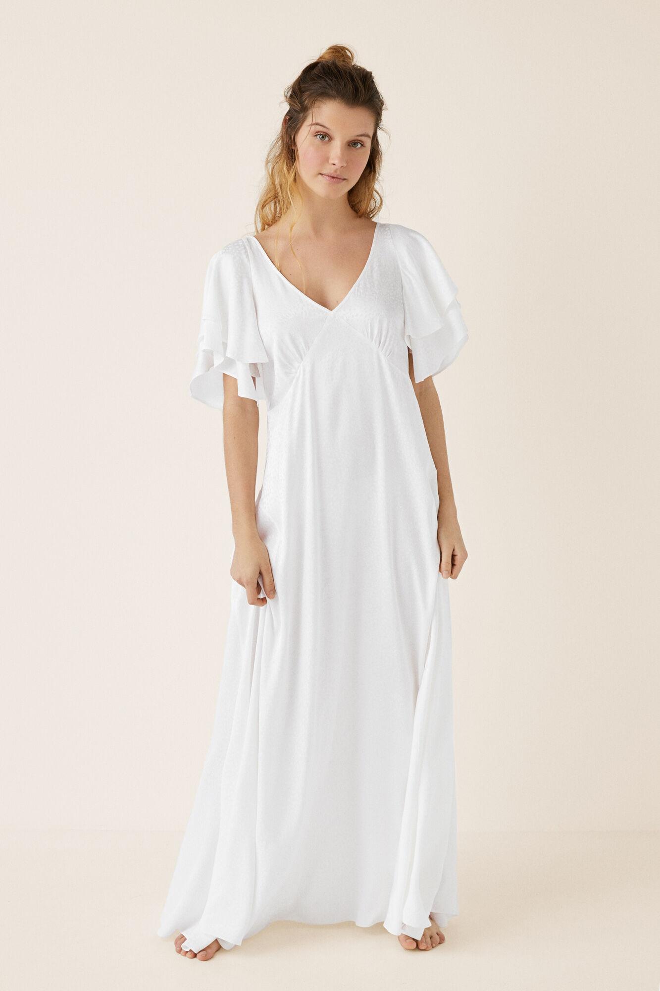 bd907bc903 Vestido largo blanco con volantes
